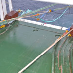 The 1.2t toe-end weights are shot, with the lifeline clipped onto the upper starboard wing of the trawl.