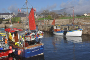 The Mourne mountains loom large over Priscilla Jean and William Alexander, berthed in Annalong harbour.
