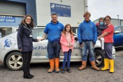 Mission area officer Claire McIntosh receives the £1,600 cheque from Cas Par Cas Scotland director Neal Forman and his family.